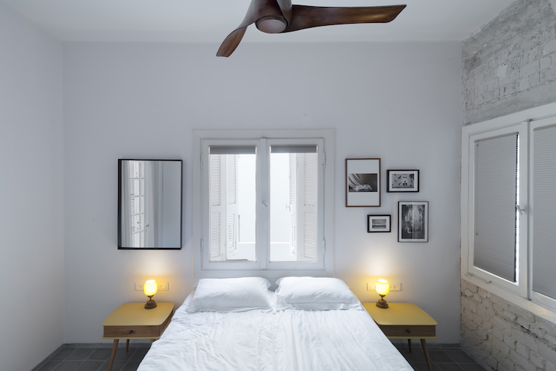 The overall interior design of the apartment is simple, almost austere, featuring a neutral color palette