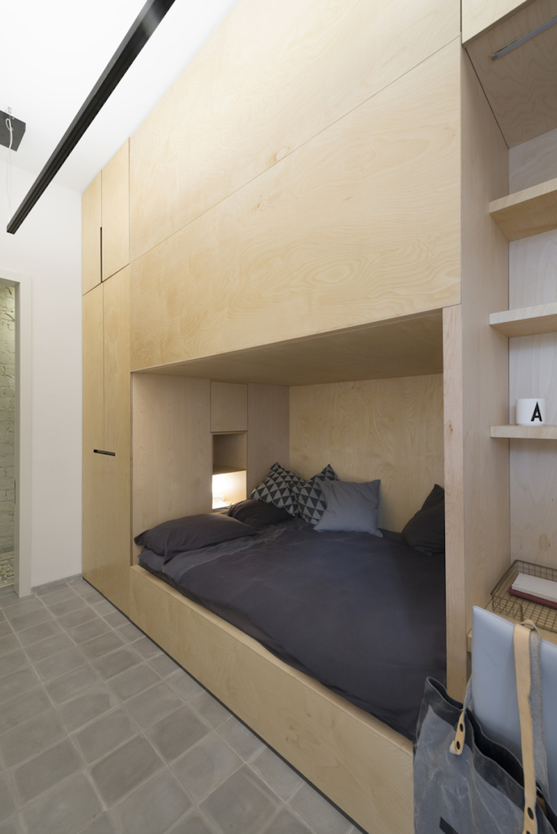 One of the bedroom is shared in two sections by a divider and has bunk beds that save floor space